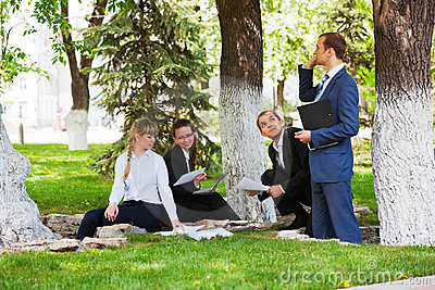 Young business people working in a city park Stock Photo
