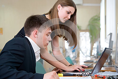 Young business people work in a computer class