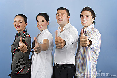 Young business team giving thumbs up