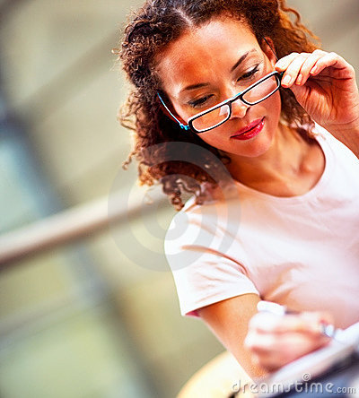 Young business woman adjusting her spectacles