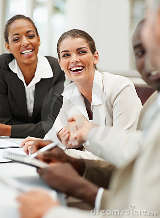 Young business woman being congratulated by boss