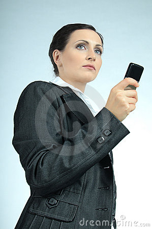 Young business woman, concentrated looking forward