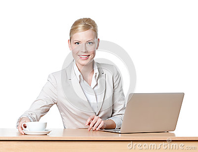 Young business woman with a cup of tea