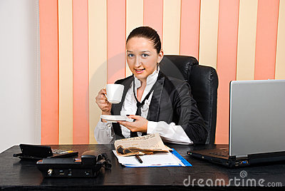 Young business woman drink a cup of coffee