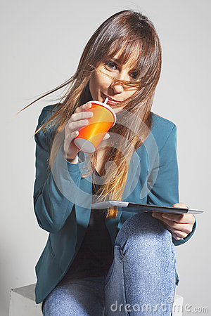 Young business woman drinking refreshment using straw