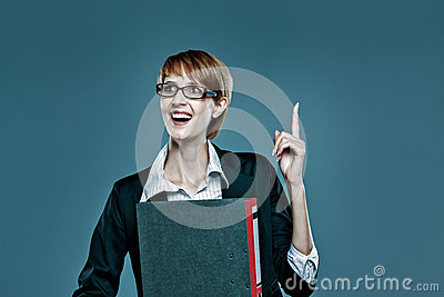Young business woman gesturing with her finger and holding a folder