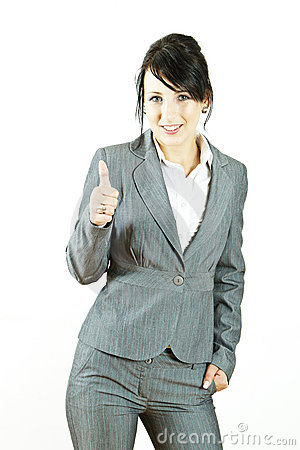 Young business woman giving thumbs up