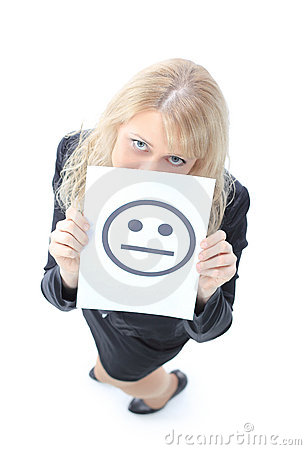Young business woman hiding behind a smiley face