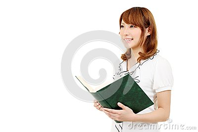 Young business woman holding a book