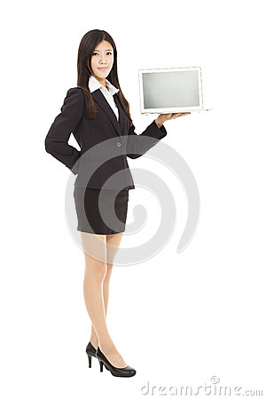 young business woman holding laptop