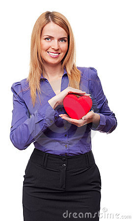 Young business woman holding red heart and smiling