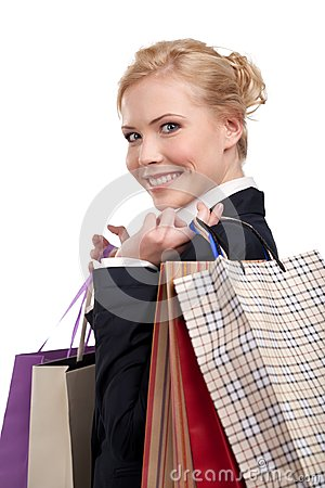 Young business woman holding shopping bags