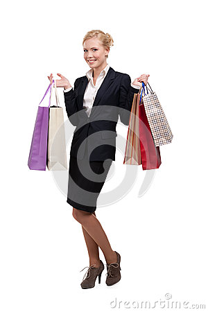 Young business woman in holding shopping bags
