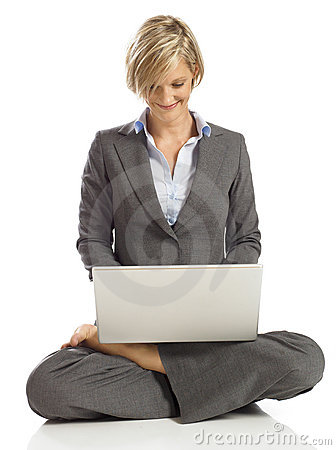 Young Business woman in a lotus pose with laptop