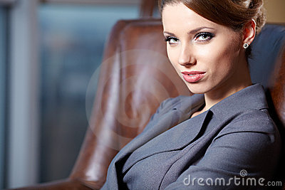 Young  business woman in modern office.