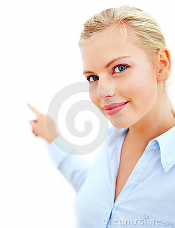 Young business woman pointing towards copyspace