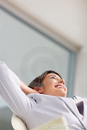 Young business woman relaxing , looking upwards