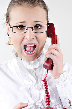 Young business woman screaming on the phone.