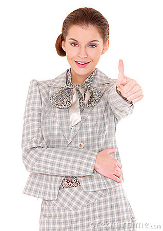Young business woman showing thumb up gesture
