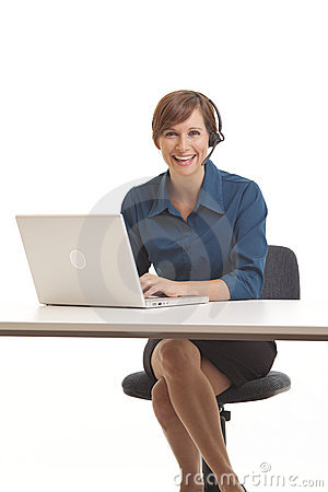 Young business woman sitting at desk