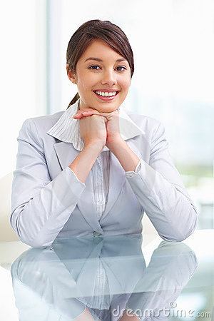 Young business woman sitting at a glass table