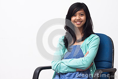 Portrait of young business woman sitting on chair