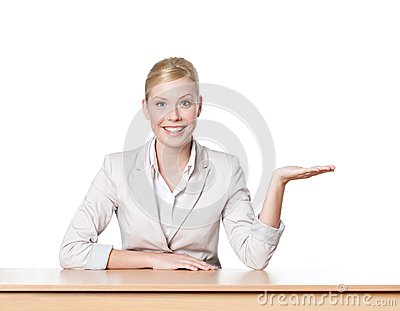 Young business woman sitting at a office table