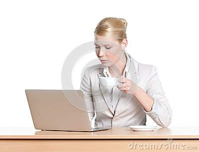 Young business woman sitting at a office table with laptop