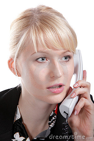 The young business woman speaks by phone