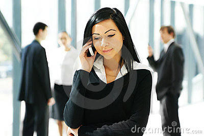 A Young Business Woman Talking On The Phone Royalty Free Stock Images - Image: 16480259