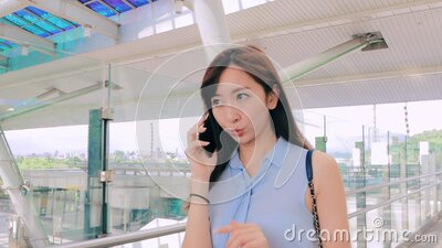 Young business woman talking on the phone in  train station stock video