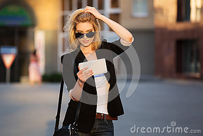 Fashion business woman using a tablet computer
