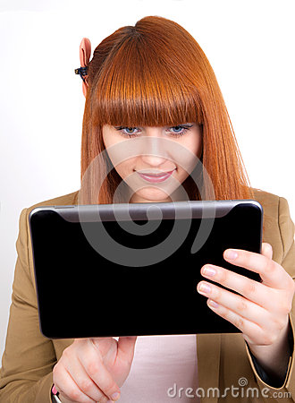 Young business woman watching on Tablet PC