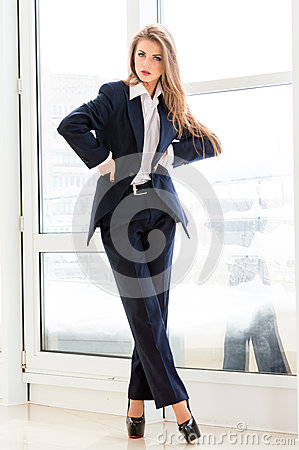 Young Business Woman Wearing Man S Suit And High Heels In