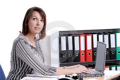 Young business woman working in her office