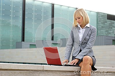 A young business woman working with a laptop