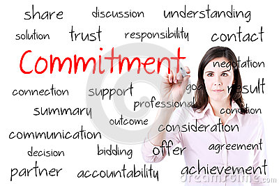 Young business woman writing commitment concept. Isolated on white.