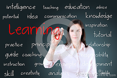 Young business woman writing learning concept