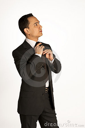 Young businessman adjusting a tie
