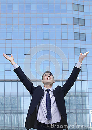 Young Businessman with arms raised