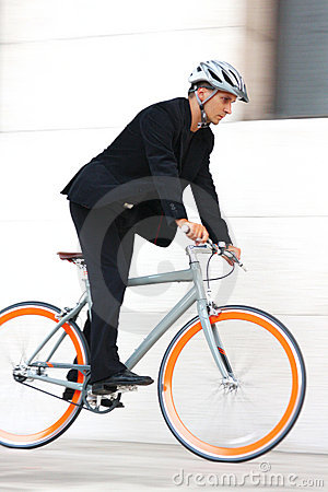 Young businessman biking to work