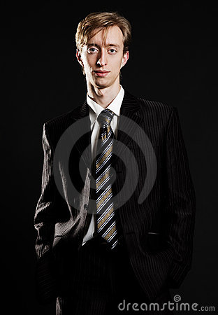 Young businessman in black suit