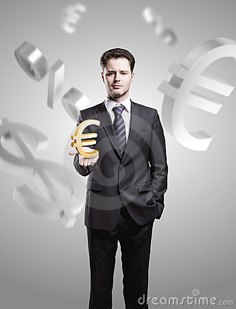 Young  businessman chooses a Gold Euro Sign