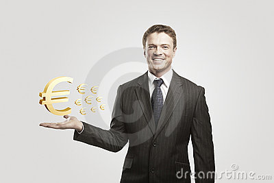 Young  businessman chooses a Gold Euro Signs.