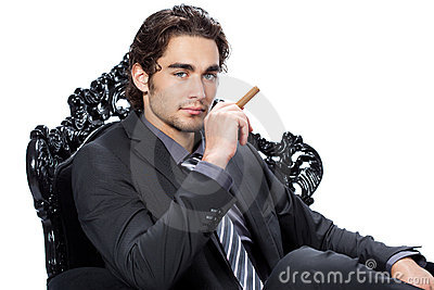 Young businessman with cigar