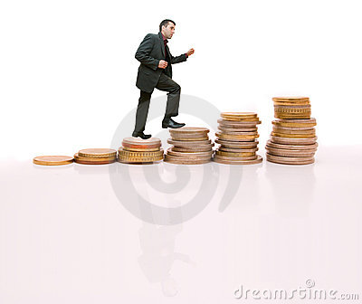 Young businessman climbing the steps made of coins