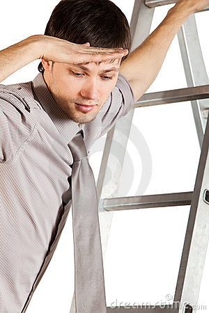 Young Businessman climbink n ladder.Isolated