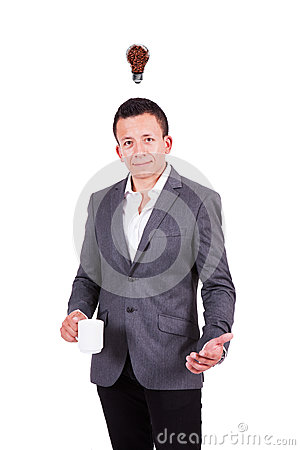 Young businessman with coffee bulb over his head Stock Photo