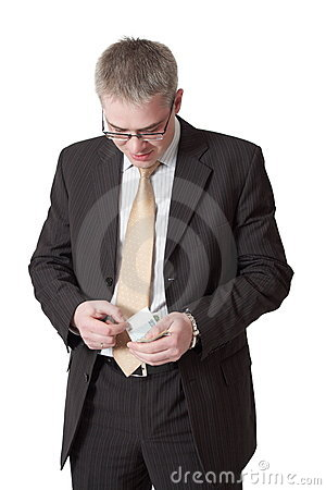 Young businessman counts money
