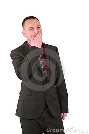 Young businessman covering his mouth with his hand